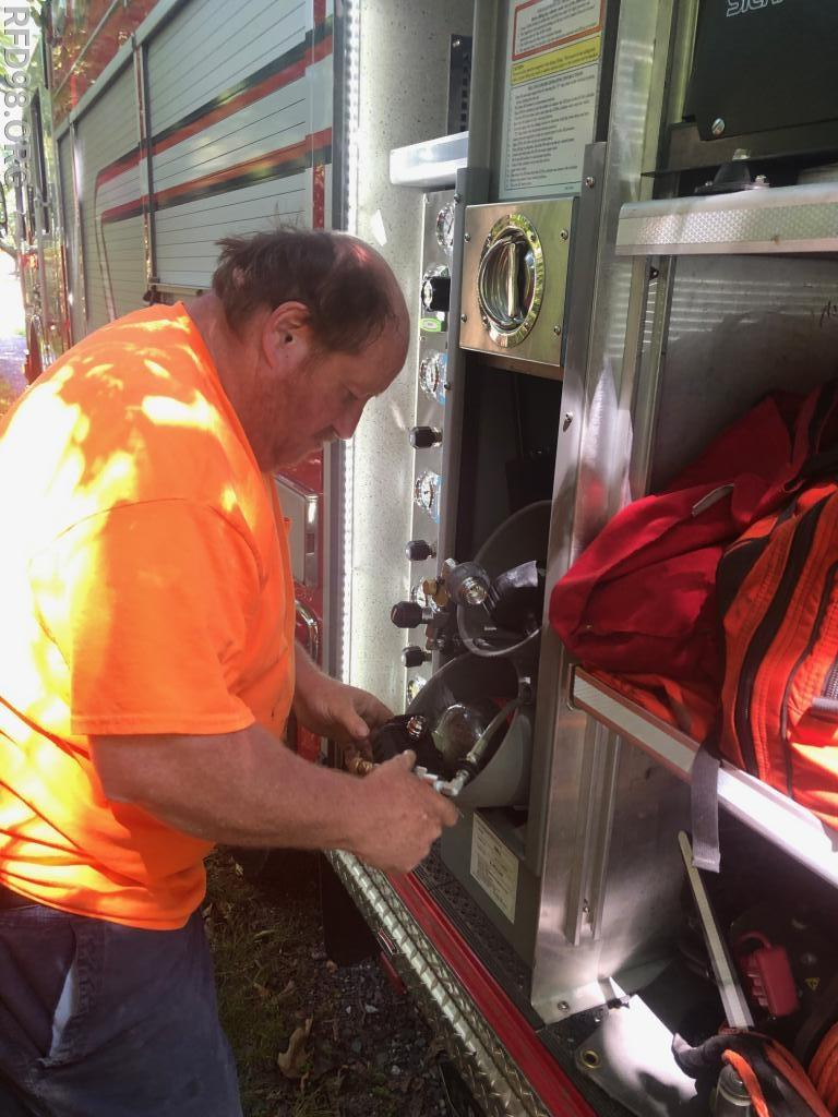 Operator Terry Frymoyer refilling air cylinders onscene using the cascade system