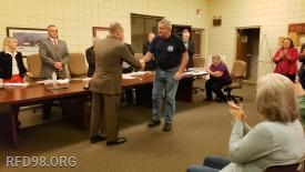 Ridge Fire Company Deputy Chief Roger Kolb accepting the commendation on behalf of Lieutenant Jack Clark