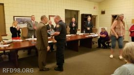 """EMT Matt Lex being presented with the """"Life Saving Commendation"""""""